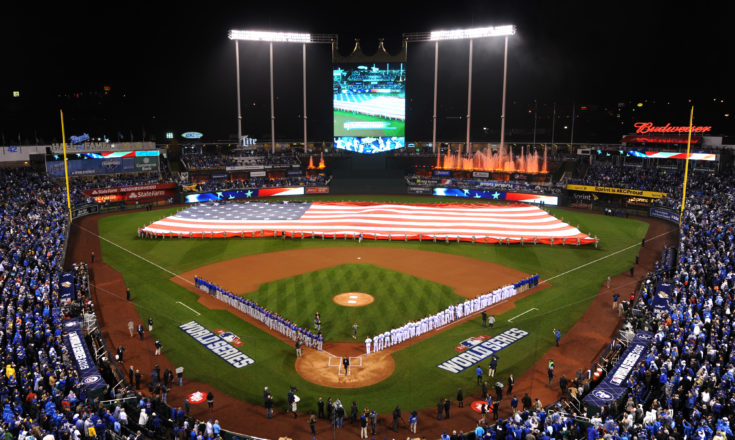 Members of Team Whiteman take part in a flag ceremony during pregame ceremonies of the World Series game one at Kauffman Stadium in Kansas City, Mo., Oct. 27, 2015.  More than 100 service members participated in the flag ceremony that took place before the game where the Kansas City Royals defeated the New York Mets 5-4 in 14 innings. (U.S. Air Force photo by Tech. Sgt. Miguel Lara III/Released)