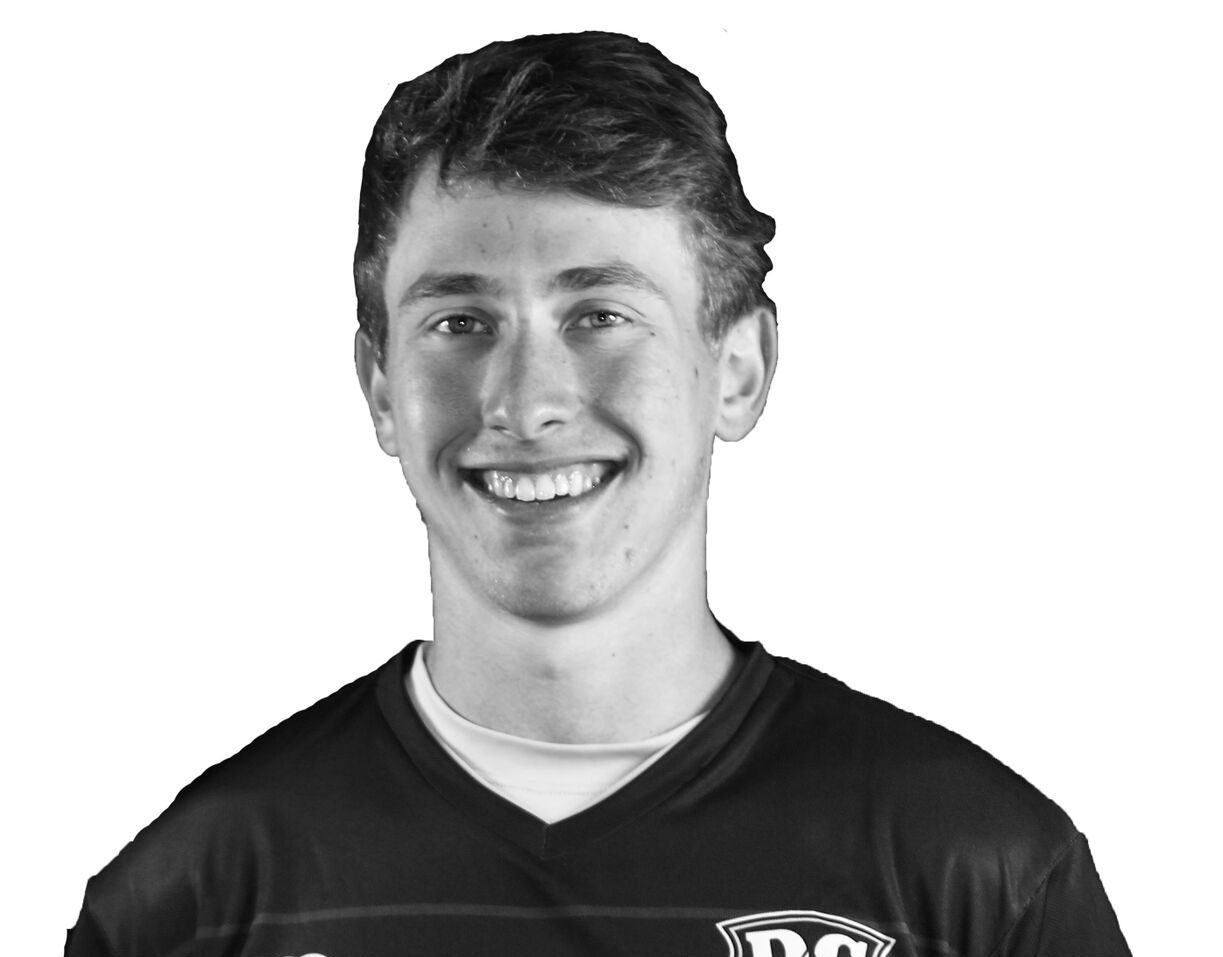 DC Current signs Wilson frisbee player