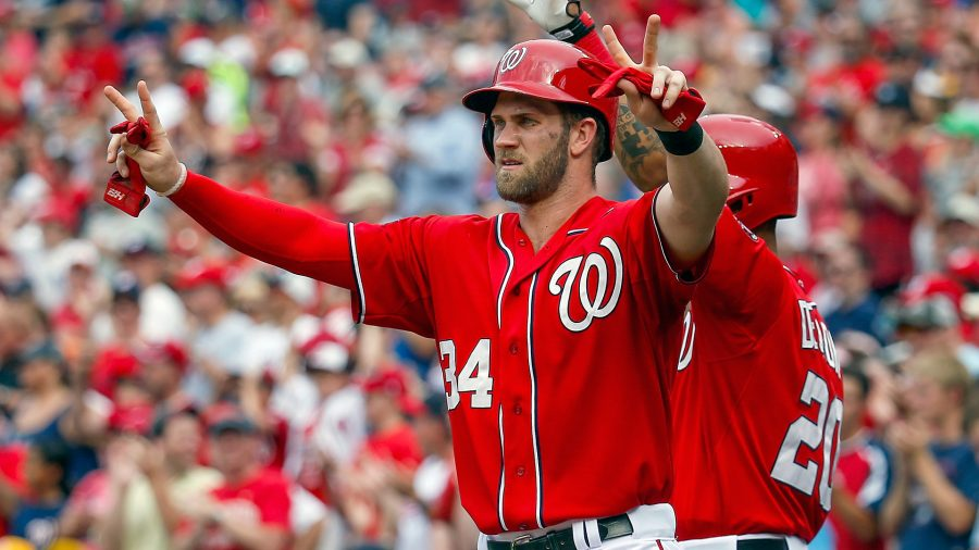 Bryce+Harper+celebrates+with+teammates+after+scoring+a+run+