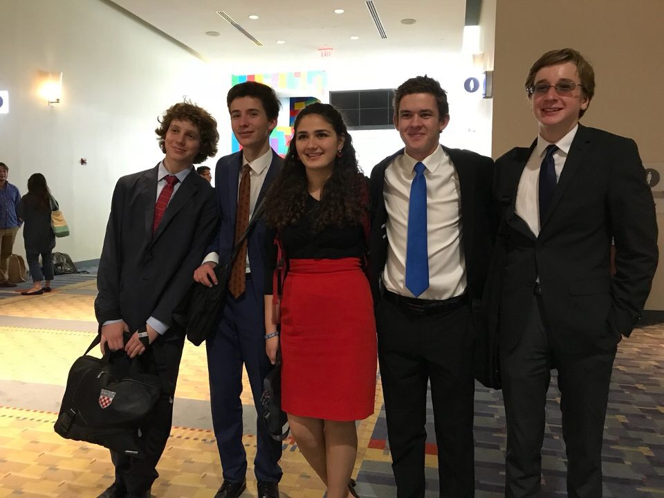 DEBATIN' WITH FINESSE- The Wilson debate team competed against hundreds of other debaters and speakers at the Grand National tournament for the Catholic Forensic League in the Washington Convention Center.  Sophomore Elie Salem (far left) and freshman Tristan May (far right) advanced to the first elimination round.