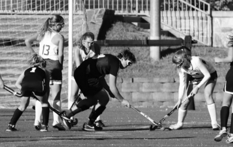 Male field hockey opponent confuses Wilson players