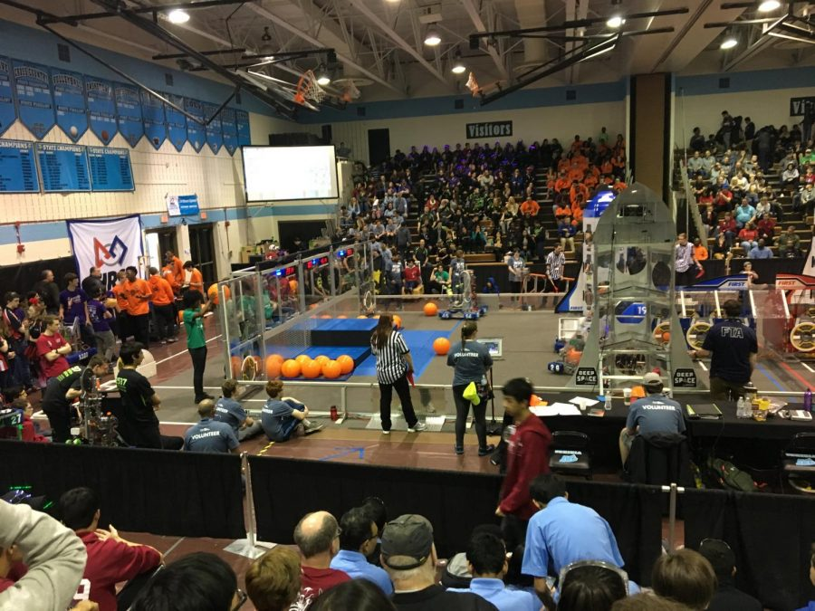 %22The+Stands%2C%22+shown+above%2C+is+where+each+match+is+held.+Two+teams+of+three+robots+each+compete+in+the+center+by+tossing+balls%2C+placing+hatches%2C+and+climbing+pedestals.+