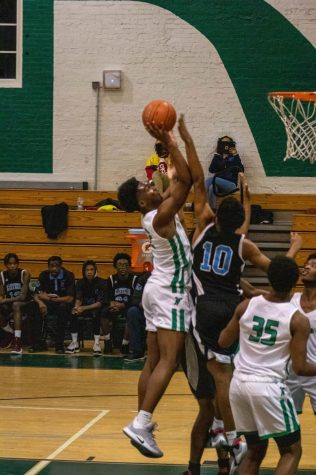 Wilson basketball opens their season with close win